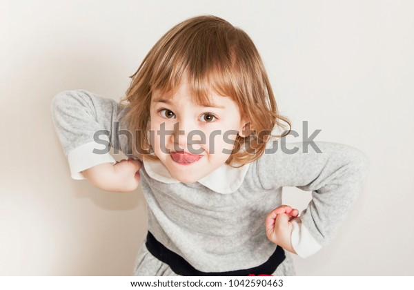 Portrait Grimacing Little Baby Girl Shows Stock Photo Edit Now 1042590463