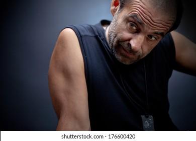 portrait of grimacing or puckering or grinning man