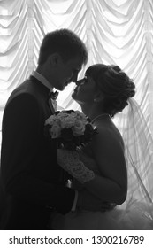 Portrait of the groom and bride.