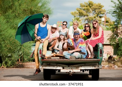 Portrait of Groovy Group in the Back of Truck