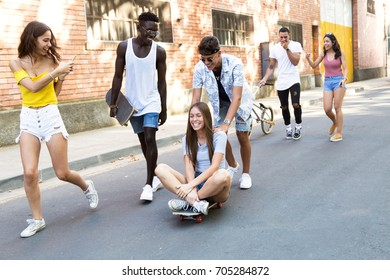 Portrait of group of active teenagers making recreational activity in an urban area.