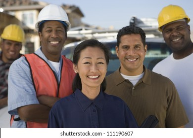 Portrait of a group of architects at construction site