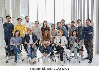 Portrait Group Of Asian and Multiethnic Business people with casual suit in happy action when project is completed in the modern workplace, people business group concept