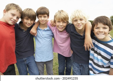 Portrait group of boys in park