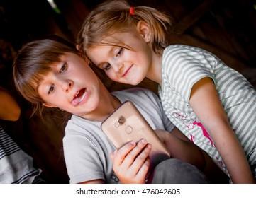 Portrait of group of children taking a selfie