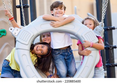 Portrait of group of childrens having fun in the park.