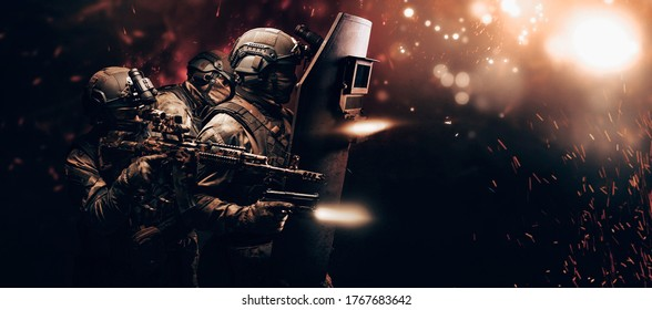 Portrait of a group of fighters of a special unit. They hide behind a bulletproof shield. Background of war. Three soldiers. The concept of the fight against terrorism. Mixed media