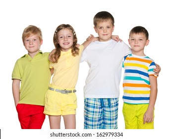 A portrait of a group of four smiling children on the white background