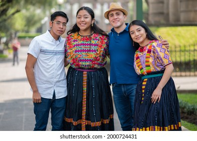 Portrait of a group of friends of different cultures in the park.