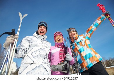 Portrait of group of friends with skis