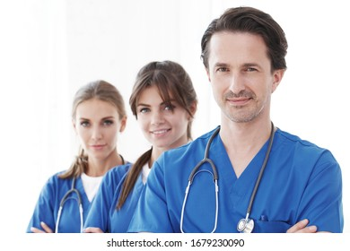 Portrait of group of smiling hospital colleagues standing together isolated on white background