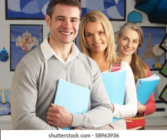 Portrait Of Group Of Teachers In Classroom