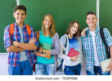 Portrait  group of  teens in classroom background green board