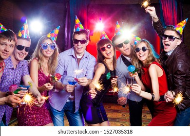 Portrait of group teens on Holiday party in nigh club