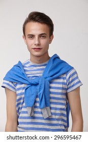 Portrait of a guy in a blue striped clothes