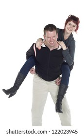 Portrait of guy giving piggy back ride to his girlfriend against white background