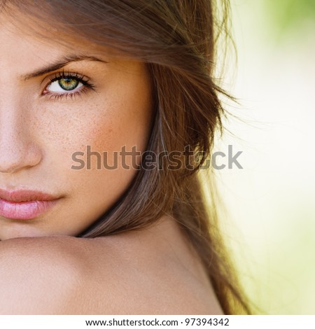 Portrait Half Face Of Beautiful Sexy Girls With Dark Hair And Bare Shoulders Seductively On Green