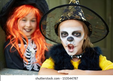 Portrait of Halloween girls looking at camera