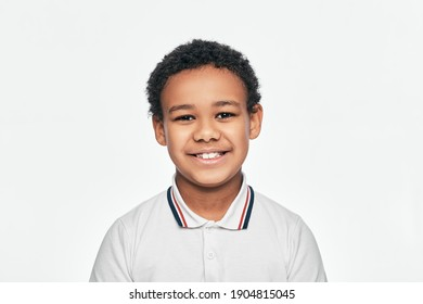Portrait of a handsome African American boy with toothy smile. Isolated on white background