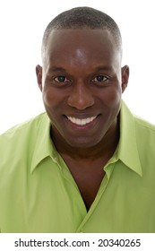 Portrait of a handsome African American man in a bright green shirt and smiling looking directly into the camera.