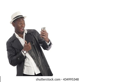 Portrait of a handsome african american man using smartphone over white background