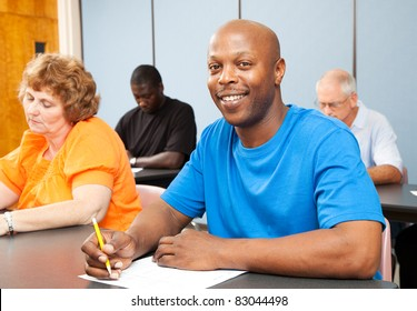 Portrait of a handsome African-american college student in adult education class.