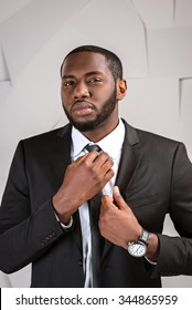 Portrait of handsome afro american businessman. Young stylish businessman looking at camera. Man wearing suit and tie
