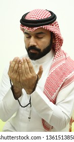 Portrait Of A Handsome Arab Muslim Model Praying With His Eyes Closed ( Ramadan Fasting Pray )