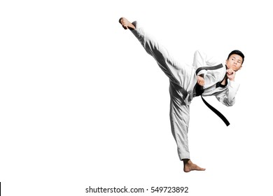 Portrait of a handsome asian man kick with taekwondo black belt . Isolated on white background with copy space