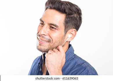 portrait of a handsome asian men listening music on a earphone