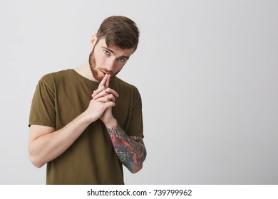 Short haired tattoed mature