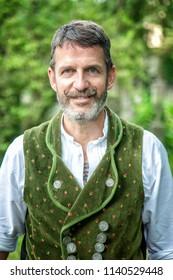 portrait of handsome bavarian man standing outdoors