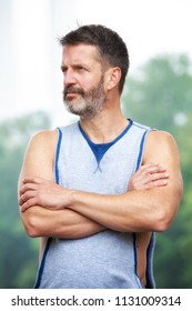 portrait of handsome bearded athlete standing outdoors