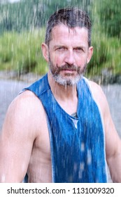 portrait of handsome bearded athlete  standing outdoors in the rain