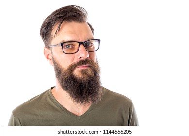 Portrait of a handsome bearded man in glasses on white background