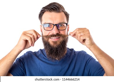 Portrait of a handsome bearded man with glasses holding his mustache on white background