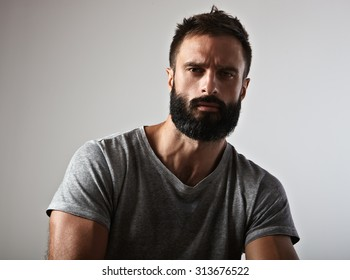 Portrait of a handsome bearded man looking at camera