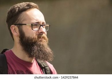 Portrait of handsome bearded Young Man Wearing Eyeglasses