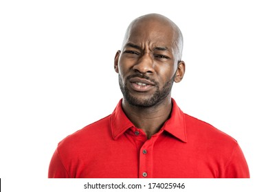 Portrait of a handsome black man with doubtful expression isolated on white background