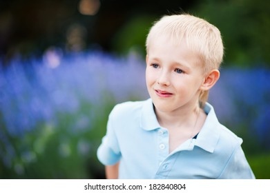 portrait of handsome blond boy on the background of lavender