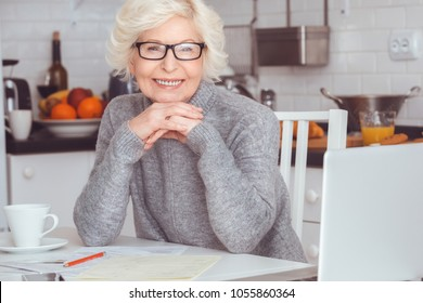 Portrait of handsome blonde adult businesswoman toothy smile