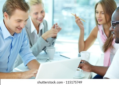 Portrait of handsome boss typing in working environment
