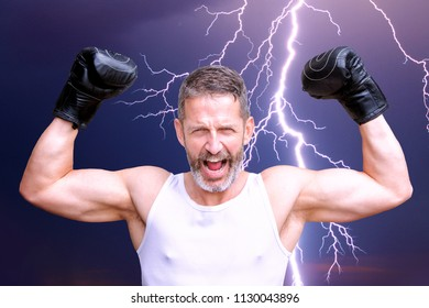 portrait of handsome boxer in victory pose in front of thunderbolt