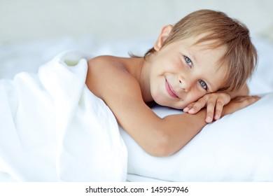 Portrait of a handsome boy awakened
