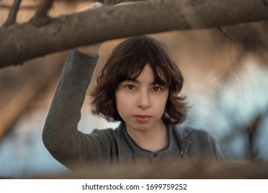 Portrait of a handsome boy on a background of nature. Face close-up.