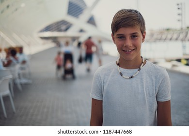 Portrait of a handsome boy smiling while standing outside