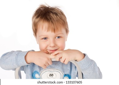 A portrait of a handsome boy.Young boy on the top stairs. White background