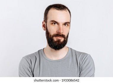 Portrait of a handsome brutal brunette serious man on a white background. The person will soon become the owner of a startup business.