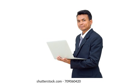 Portrait of a handsome business man in black suit with a laptop in hand on white background
