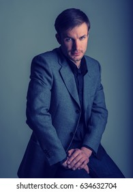 Portrait of a handsome business man on a dark background